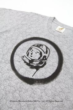 """Billionaire Boys Club has teamed up once again with world-renowned artist Takashi Murakami, and for this latest go-round the collaboration takes the form of a small capsule made up of a crewneck sweatshirt and tees. The pieces feature artwork fromMurakami's Ensō series, which translates into """"circle,"""" symbolizing emptiness, unity, and infinity in Zen Buddhism. Here, the circular motif is accompanied by the BBC helmet and rendered with spray paint, which is then digitized ..."""