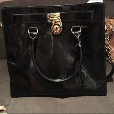 Michael Kors Black Hamilton patent leather NS tote Authentic brand new without tags tote, with 5 interior pockets; 1 zip & 4 slide in of which one is pleated and a key hook. Magnetic center snap top closure. Gold tone lock in front with dust bag included. Michael Kors Bags Totes