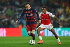 Lionel Messi of Barcelona and Alex Iwobi of Arsenal compete for the ball during the UEFA Champions League round of 16, second Leg match between FC Barcelona and Arsenal FC at Camp Nou on March 16, 2016 in Barcelona