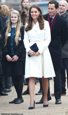 Catherine, Duchess of Cambridge, aka Kate Middleton, visiting the new headquarters of the 1851 Trust in Portsmouth. Kate is wearing the Villar style coat by Max Mara, the Boat Print Dress by Alice Temperley's diffusion line from Somerset for John Lewis, LK Bennett 'Frome' clutch, and 'Georgia' heels by Jimmy Choo. 02/12/15