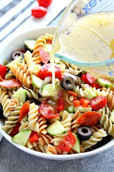 Italian Pasta Salad Recipe - rotini pasta, cherry tomatoes, cucumber, olives, pepperoni and fresh mozzarella tossed with homemade Italian dressing. Easy and delicious! all about pasta Greek Salad Pasta, Pasta Salad Italian, Pasta Salad With Cucumber, Summer Pasta Salad, Tortellini, Penne, Pepperoni Pasta Salads, Pepperoni Slices, Homemade Italian Dressing