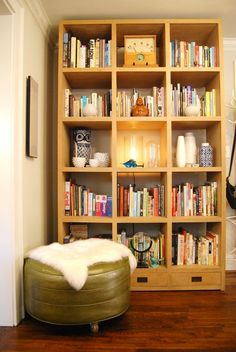 perfect bookshelves. floor to ceiling cube shelving.    Name: Liza Monteagudo and David E. Peterson + Dog, Paco Location: Grant Park — Atlanta, Georgia Size: 1,100 square feet Years lived in: 2.5 years Designer and DIY guru Liza Monteagudo and abstract painter David E. Peterson have created an eclectic, creative home in the Grant Park neighborhood of Atlanta. It's a treasure trove of David's paintings, art from Liza's home of Puerto Rico, carefully chosen antiques, and plenty of clever DIYs.