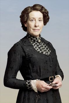 Mrs. Hughes.Elsie Hughes is the housekeeper at Downton and the female staff all report to her.Though unmarried,she is referred to as Mrs. Hughes in keeping with the traditional titles for servants at the time.
