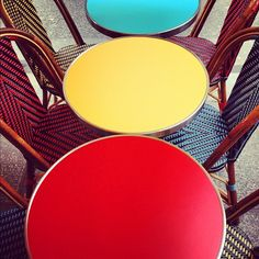 Colorful cafe tables & chairs in Paris. #ourchoix