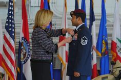 Secretary of Air Force Deborah Lee James pins Air Force Cross to uniform of Master Sgt.Ivan Ruiz,pararescueman from 56th Rescue Squadron,Royal Air Force Lakenheath,England,during ceremony at Freedom Hangar,Hurlburt Field,Fla.,Dec.17,2014.While deployed to Afghanistan with 22nd Expeditionary Special Tactics Squadron,Ruiz protected injured special ops forces teammates with fire support & provided emergency medical care under intense enemy fire in dark,Dec.10,2013.