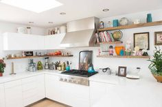 love the floating shelves in the kitchen. at home with Cat Deeley