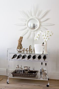 This white and gold themed bar cart is a must-have for any hostess!