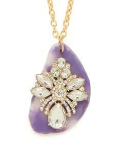 This stunning necklace flaunts both a bold glamour and whimsical femininity. We especially love that lilac slice of agate that's topped with a beautiful cluster of sparkling gems.