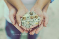 Here is a great idea for a Save the date photograph on the beach! Beach engagement shoots are a lot of fun and there are many ways to get creative with it! Seashells sand, engagement rings, love
