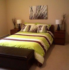 Great idea of : Walls =tan Furniture =Brown White accents Bedspread= Green and brown (i would try to find a lighter green bedspread)