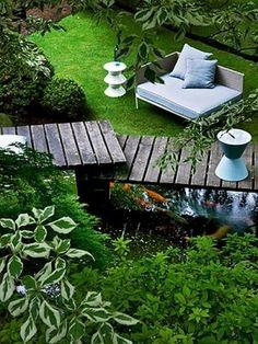 Elevated garden boardwalk – koi pond I want this back yard so bad !!