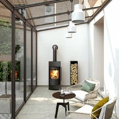 Kaminofen Luno Kaminofen Luno toll hier im Wintergarten! The post Kaminofen Luno appeared first on Wohnzimmer ideen. House Extension Design, Glass Extension, Rear Extension, Extension Ideas, Garden Room Extensions, House Extensions, Kitchen Extensions, Living Room Decor Cozy, Glass House