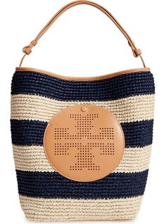 Absolutely adoring this Tory Burch hobo bag that adds a beachy vibe to any look with its vintage woven straw.
