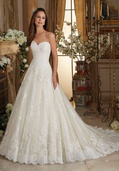 5473 Wedding Dresses and Bridal Gowns by Morilee designed by Madeline Gardner. Chantilly and Embroidered Lace on Tulle Ball Gown Wedding Dress with Scalloped Hemline