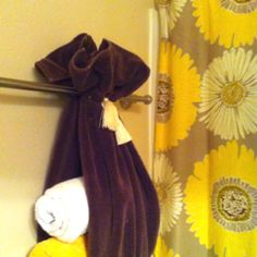A large towel tied with tassels used to store bath towels - cute and easy to do:)