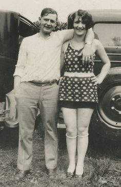 A young 1920s couple, woman wearing a cute polka dot bathing suit and knee high stockings.