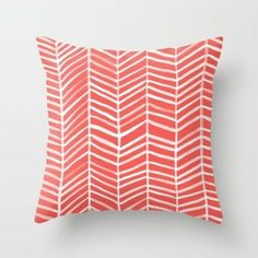 """25 Decor Pieces Under $50 to Glam Up Any Room: CORAL HERRINGBONE THROW PILLOW COVER. This head-turning pillow will take any sofa from drab to fab. ($20 for 16"""" x 16"""" cover; Society 6)"""