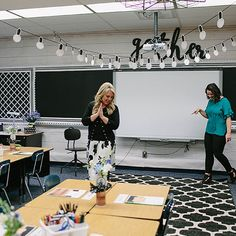 i like the slightly industrial, rustic theme in a classroom. this would be my overall theme in my classroom. i especially like the hanging lights in this classroom, because they add another element and make the classroom seem taller.