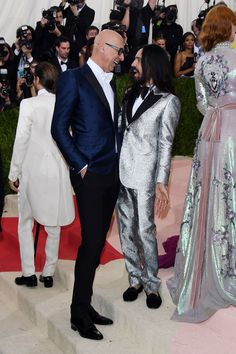 At the Met Gala, Gucci CEO Marco Bizzarri in a peak lapel tuxedo featuring bee embroidery and creative director Alessandro Michele in a Heritage peak lapel one-button brocade tuxedo.