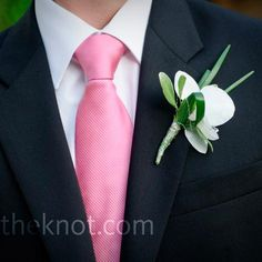 If we go with the rose, something like this then. White for the groom, and pink for the groomsmen