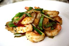 This is one of our favorite ways to cook shrimp, and seafood in general. The combination of scallion and ginger in a hot wok really can't be beat. Make sure your heat is pretty high for