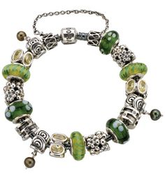 Pandora Bracelets, Could have a variety of beads, colors, style and interchange bracelets to match outfit...love this idea.