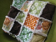 orange, brown and green rag quilt.