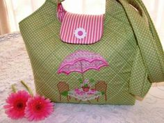 A charming quilted handbag featuring an al fresco garden scene with a table set for tea. Machine Embroidery Projects, Embroidery Software, Machine Embroidery Applique, Custom Embroidery, Cross Stitch Embroidery, Embroidery Patterns, Garden Bags, Quilted Handbags, Handmade Bags