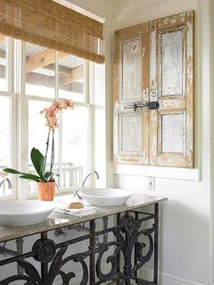 Salvaged Charm: Salvage is right up our alley!  Our home consists of so many salvaged elements already, so this would definitely work.  Though I love this look, and could put a window above the vanity, I think a mirror over the sink is more practical for us.