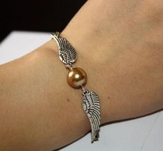 Golden Snitch Bracelet In Silver Steampunk Harry by BeautyandLuck - haha love you alyson <3