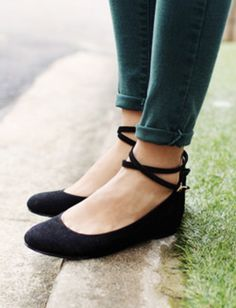 Cute black ballet flats with ankle straps in combination with trousers