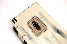 http://www.etsy.com/listing/70512292/unique-handmade-journal-wood-book-black?ref=v1_other_2
