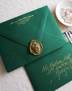 When you have a bride-to-be having an eyeball for design a Christmastime wedding party, it creates a stationer like me the happiest! 🌲✨ Gold foil-stamped return address, gold calligraphy addressing, emerald green envelopes, gold wax seal Wedding Party Invites, Wedding Stationery, Wedding Planner, Wedding Stamps, Wedding Envelopes, Gold Calligraphy, Calligraphy Envelope, Slytherin Aesthetic, Wax Seal Stamp