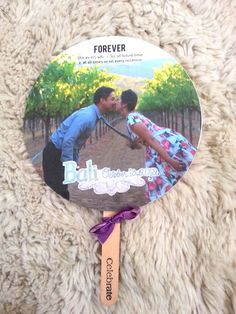 Amazing DIY wedding fans I made for my sister's wedding in Bali. The bride and groom's love story is on the back. Great wedding favor.