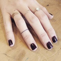 Minimalist ring tattoo on the right ring finger. Tattoo Artist: Sarah March