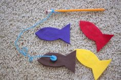 "Fish are made of felt, with washers in them. Add a magnet to the end of the ""pole"" and it's a portable fishing game"