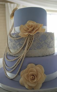 This is a Vintage  inspired Pearl and Lace Wedding Cake with Sugar Roses