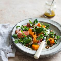 Salad of roast squash with serrano ham and manchego - This is extremely simple and healthy, but substantial enough to serve as a midweek supper. If required, the squash and pumpkin seeds can be roasted a few hours in advance. Heat the squash through in a warm oven when needed or serve at room temperature.  Recipe by Alice Hart, photograph by Laura Edwards, styling by Ali Brown. http://www.hglivingbeautifully.com/2015/01/20/winter-salad-of-roast-squash-with-serrano-ham-and-manchego/