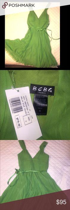 BCBG Green Silk Sleeveless A-Line w/ satin belt Gorgeous dress from BCBG Paris still has tags on it. Never ended up wearing it & I am still hanging on to it but if you love it like I do, make me an offer. Thanks! BCBG Dresses Midi