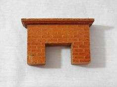 A personal favorite from my Etsy shop https://www.etsy.com/listing/480255913/strombecker-wood-dollhouse-fireplace