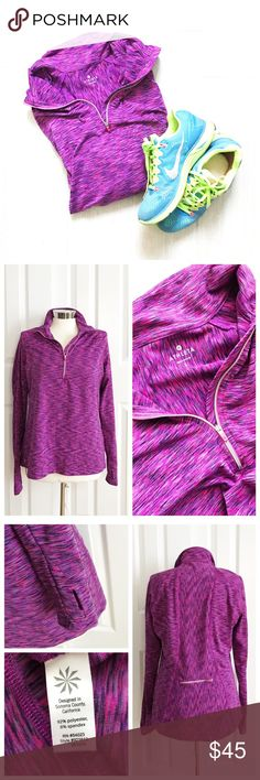 Athleta Long Sleeve Half Zip Multi colored purple pink long sleeve half zip with thumb holes and zipper pocket on back. Great color! Athleta brand. Athleta Tops