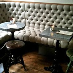 Rebekah Zaveloff - terrific tufted banquette - love the little marble pub tables and the victorian piano stool