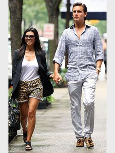 Love how he matches her shorts with his shoes. By far the best dressed couple in Hollywood.