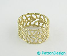 A unique seafan inspired gold ring at RI Patton Goldsmithing in the Mongoose Junction Shops in Cruz Bay, Saint John, USVI. Unique, creative ...beautiful! http://www.pattongold.com