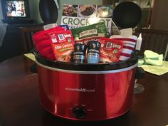 Finished crockpot basket for charity raffle. Kitchen Gift Baskets, Gift Baskets For Men, Cheap Wedding Gifts, Wedding Gift Baskets, Fundraiser Baskets, Raffle Baskets, Theme Baskets, Themed Gift Baskets, Chinese Auction