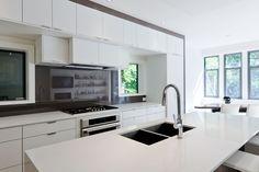 gloss-white kitchen with glass backsplash