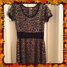 Julian Taylor NY Leopard Print Dress Julian Taylor New York Leopard Print Short sleeve sweater dress.  Looks great alone or under a jacket or cardi.  Size Large 97% acrylic; 3% Spandex.  New without tags.  Worn by model in pic. Julian Taylor New York Dresses