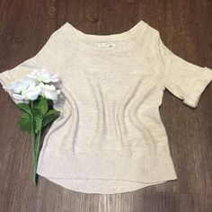 LOFT Sparkly Ivory Sweater Great condition boat neck sweater. It is shimmery but hard to see in pictures. From shoulder to bottom is 23 inches. Bust is 16 inches. One day shipping. No trades and no holds. 20% off bundles. LOFT Sweaters Crew & Scoop Necks