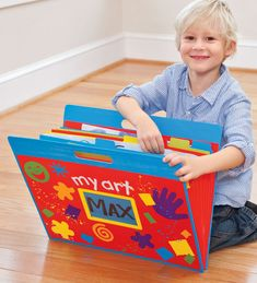 Aggghhh! I need to get a handle on all of this kid art. Maybe DIY something like this that can be stored flat?