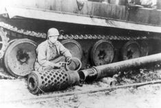 Allied soldier inspecting the 12.8 KwK gun to be mounted on the E-100